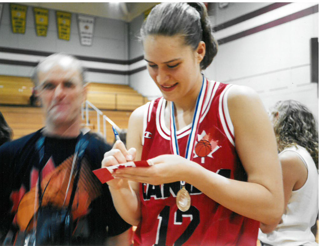 Jerant signing autographs after winning the Olympic Games Qualifying tournament. This win gave Canada team an entrance to the 1996 Olympic games.